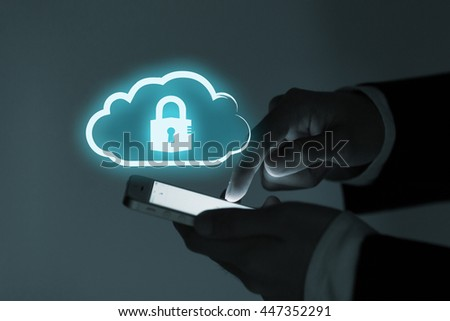 Business man use mobile phone with cloud data security services concept.