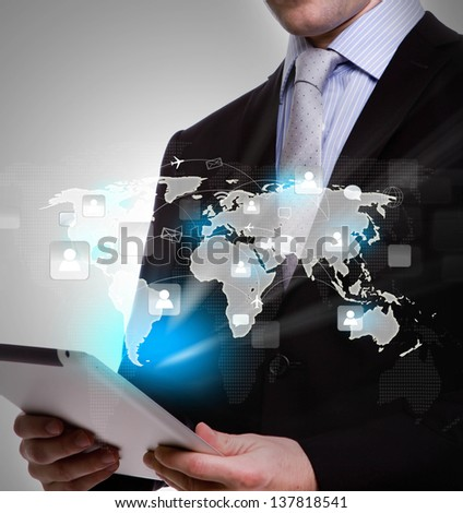 Business man using a touch screen device with social network - stock photo