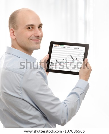 business man using a touch screen device with Stock Quotes - stock photo