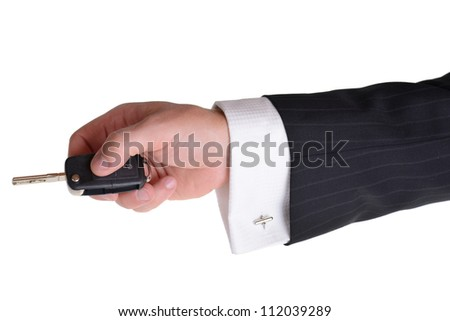 business man using car key isolated on white background - stock photo