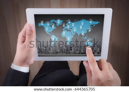 business man using digital tablet and world network concept