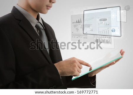 Business man using glass transparent touch screen device