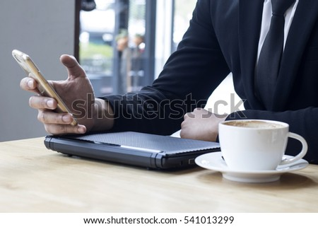 business man using internet on smart phone