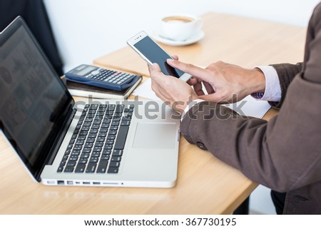 business man using internet on smart phone and laptop.