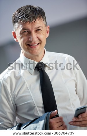 business man using phone at modern office space - stock photo