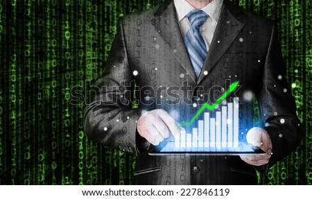 business man using tablet computer to work with financial data