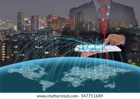 business man using tablet control the world - stock photo