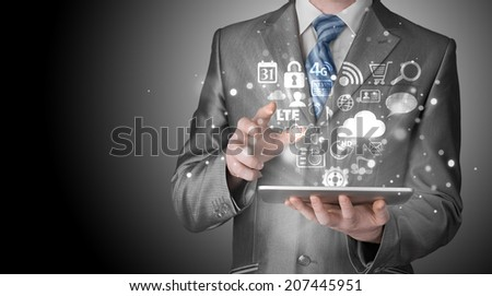 Business man using tablet PC - stock photo