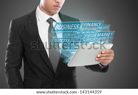 Business man using tablet PC. conceptual images of building success business - stock photo