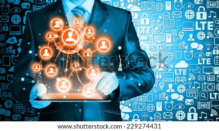 Business man using tablet PC social connection - stock photo