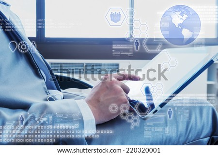 Business man using tablet with digital layer effect - stock photo