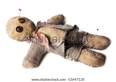 business man voodoo doll with needles laying on white