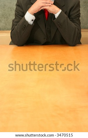 Business-man waiting at the desk, calm. - stock photo