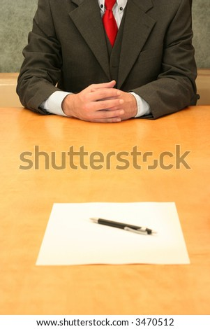Business-man waiting at the desk for you to sign the document. - stock photo