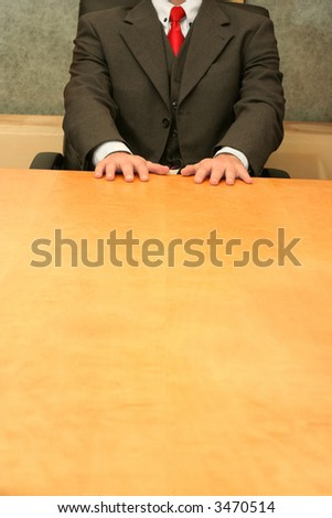Business-man waiting at the desk, open hands on the desk.