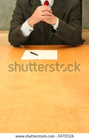 Business-man waiting at the desk, thinking over document. - stock photo