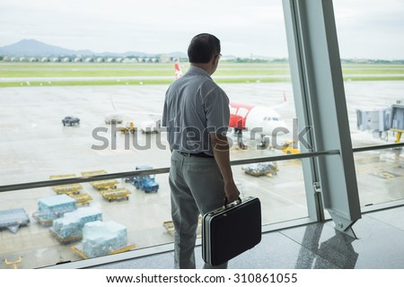 Business man waiting for departure of flight at Noi Bai International Airport - stock photo