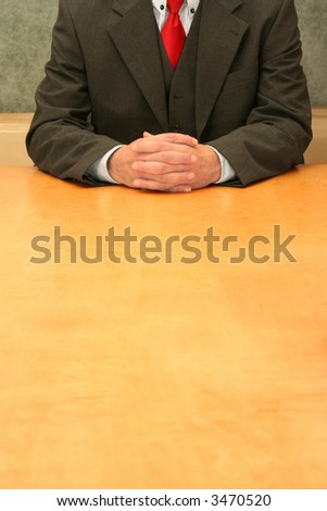 Business-man waiting sitting at the desk listening. - stock photo
