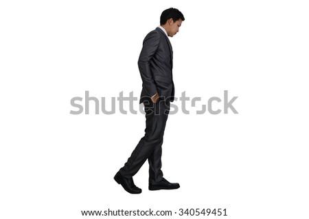 Business man walking - stock photo