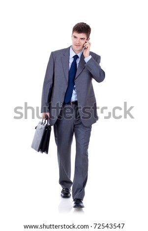 Business man Walking forward while talking on the phone over white