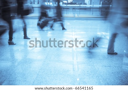 Business man walking in the airport - stock photo
