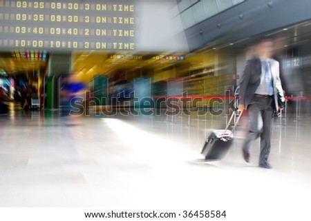 Business man walking in the Airport Terminal - stock photo