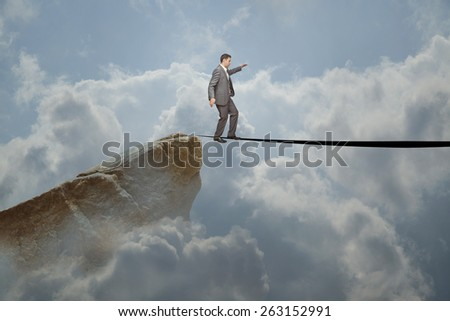 Business man walking on the line - stock photo
