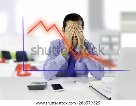 Business man watching the failure in the world of investments - stock photo