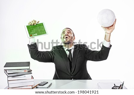 Business man watching the game on line at work - stock photo
