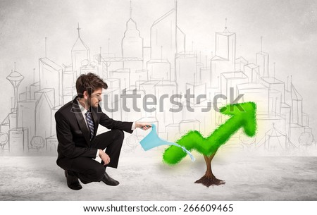 Business man watering green plant arrow concept on background - stock photo