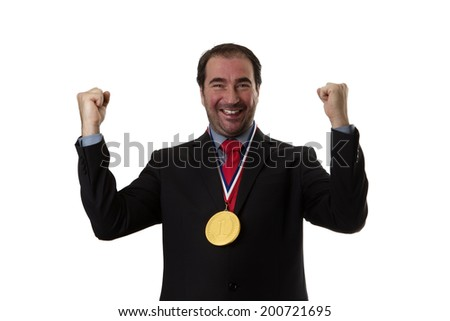 Business man wearing a chocolate gold medal around his neck  - stock photo