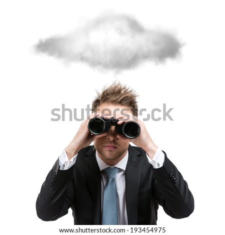Business man wearing suit with blue tie hands binocular and stands under cloud, isolated on white - stock photo