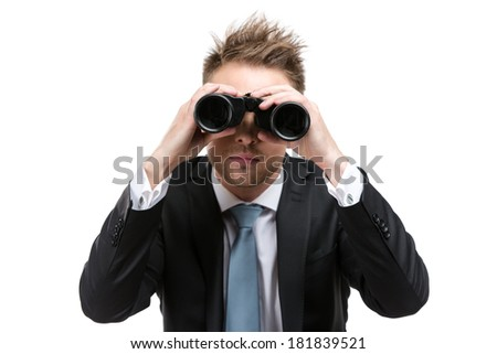 Business man wearing suit with blue tie hands binocular, isolated on white - stock photo