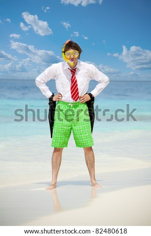 Business man wearing white shirt  and tie and also scuba, mask and holding flippers on the beach in angry pose - stock photo