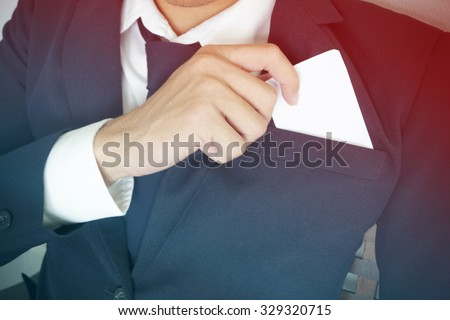business man who takes out business card from the pocket of business suit, copyspace - stock photo