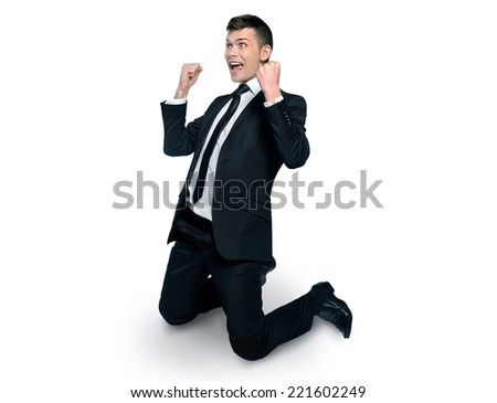 Business man winning with hands up - stock photo