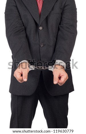 business man with a black suit in handcuffs, front view