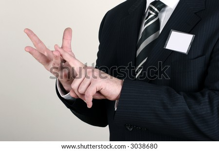 Business man with a blank nametag counting benefits - stock photo