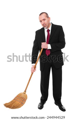 Business man with a broom is cleaning the ground - stock photo