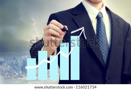Business man with a chart showing growth with city background