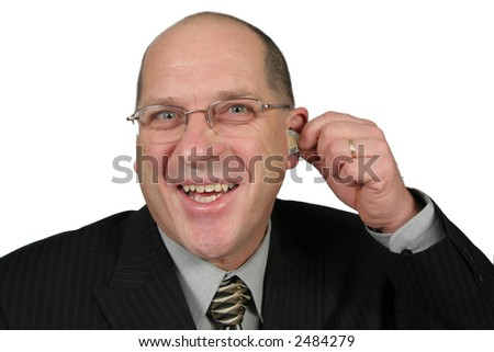 Business man with a coin coming out of his ear - stock photo
