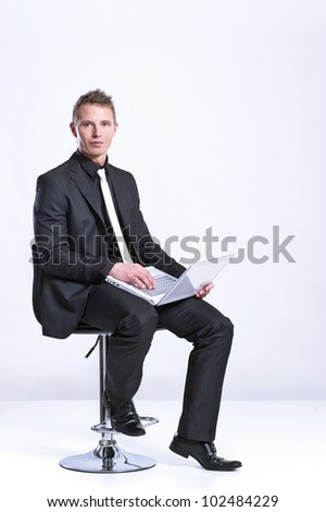 Business man with a laptop isolated over white - stock photo