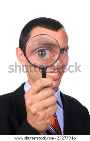 business man with a loupe - stock photo