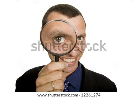 business man with a loupe isolated on white