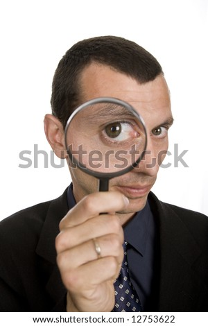 business man with a loupe isolated on white - stock photo