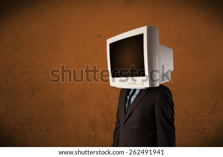 Business man with a monitor on his head concept and brown empty space - stock photo