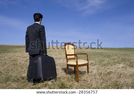 Business man with a suitcase ready to go away