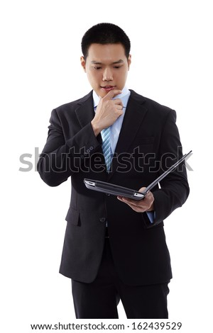 Business man with a tablet computer - Asian business man using digital tablet computer leaning against a studio isolate white background