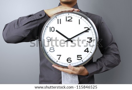 Business man with alarm a clock