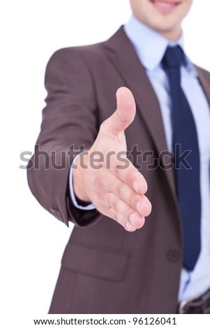 business man with an open hand ready to seal a deal. cut out young businessman welcoming you